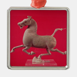 Galloping horse with one Hoof Resting on a Christmas Ornament
