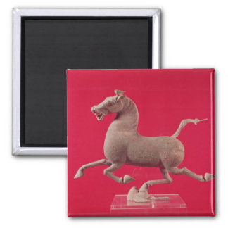 Galloping horse with one Hoof Resting on a Magnet
