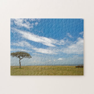 Game drive vehicle on open African plains Jigsaw Puzzle