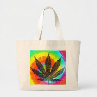 ganja leaf on rainbow background tote bag