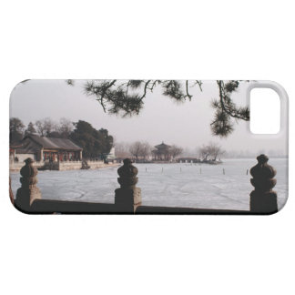 Gate and foliage by frozen lake, China iPhone 5 Cover