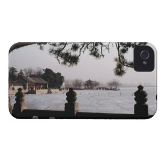Gate and foliage by frozen lake, China iPhone 4 Cover
