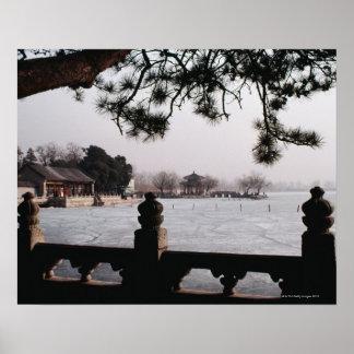 Gate and foliage by frozen lake, China Poster