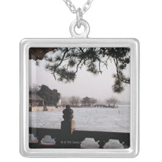 Gate and foliage by frozen lake, China Square Pendant Necklace