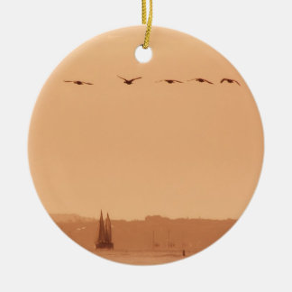 Geese flying passed a yacht in the morning round ceramic decoration