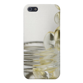 Gelcaps spilling out of glass bottle case for the iPhone 5