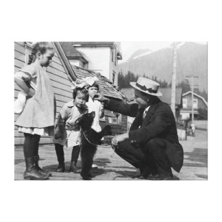 Gentleman and Kids Playing with Bear Cub On Leas Canvas Print