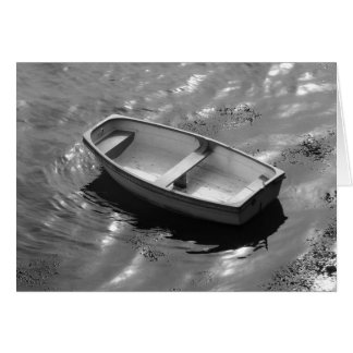 Gently rocking rowing boat on a hot summers day greeting card