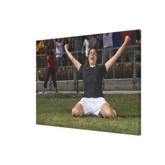 German female soccer player celebrating goal canvas print