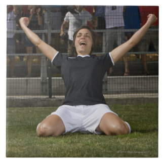 German female soccer player celebrating goal large square tile
