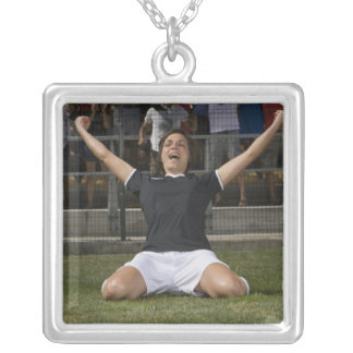 German female soccer player celebrating goal silver plated necklace