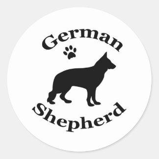 german shepherd dog black silhouette paw print round sticker