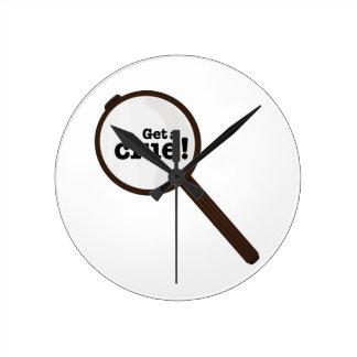 Get A Clue Round Wall Clocks