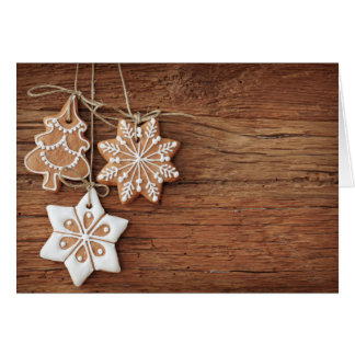Gingerbread Cookies Hanging Over Wooden Card