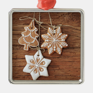 Gingerbread Cookies Hanging Over Wooden Christmas Ornament