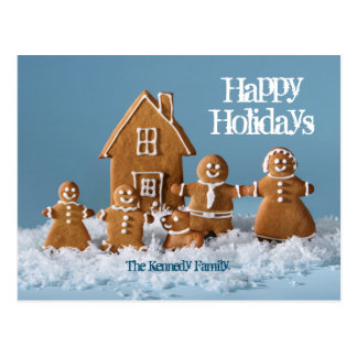 Gingerbread family in front of gingerbread house postcard