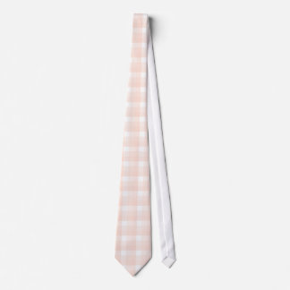 Gingham check pattern. Peach pink and white. Tie
