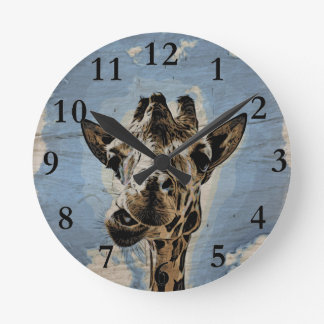 Giraffe chewing round clock
