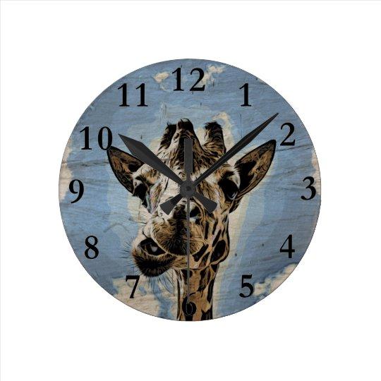 Giraffe chewing wall clock