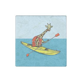 Giraffe in a kayak stone magnet