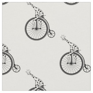 Giraffe riding a penny farthing bike fabric