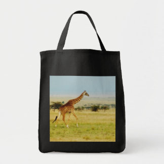 Giraffe walking Masai Mara Plains in Kenya Tote Bags