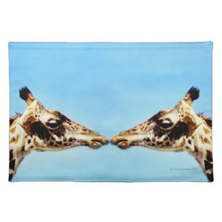 Giraffes touching noses placemat