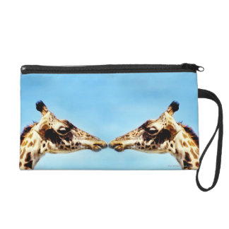 Giraffes touching noses wristlet clutches