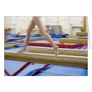 Girl (16-17) running on balance beam, low card