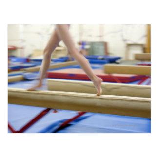 Girl (16-17) running on balance beam, low postcard