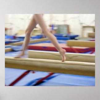 Girl (16-17) running on balance beam, low poster