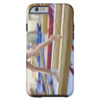 Girl (16-17) running on balance beam, low tough iPhone 6 case