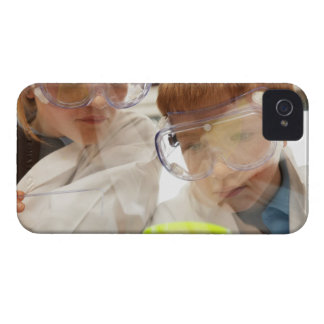 Girl and boy (11-13) looking at petri dish, view Case-Mate iPhone 4 cases
