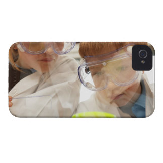 Girl and boy (11-13) looking at petri dish, view iPhone 4 Case-Mate case