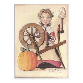 girl and spinning wheel postcard