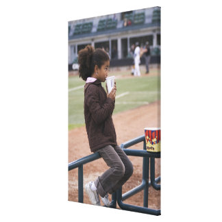 Girl at a baseball game canvas print