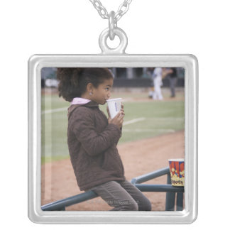 Girl at a baseball game silver plated necklace