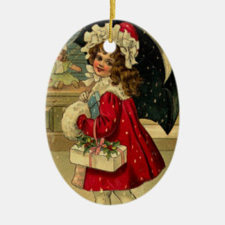 Girl carrying a christmas gift christmas ornament