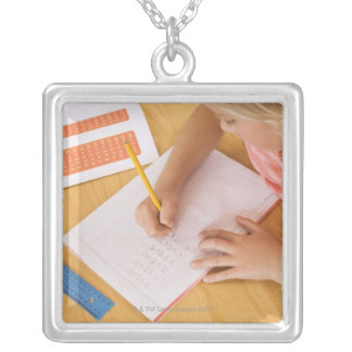 Girl doing homework silver plated necklace
