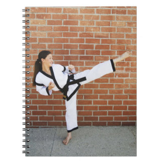 Girl doing martial arts 2 note books