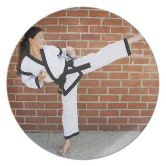 Girl doing martial arts 2 plates