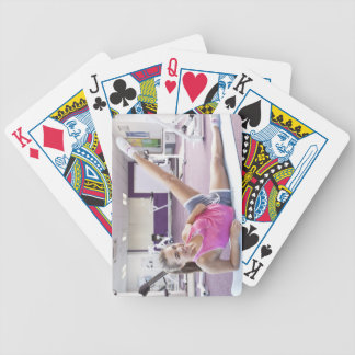 Girl Exercising in Gym Bicycle Playing Cards