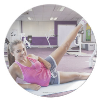 Girl Exercising in Gym Party Plates