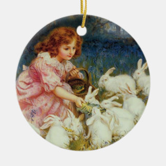 Girl feeding rabbites christmas ornament