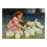 Girl feeding Rabbits Greeting Card