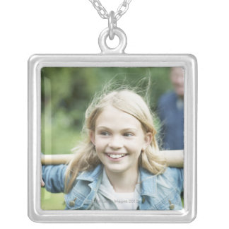 Girl holding baseball bat silver plated necklace