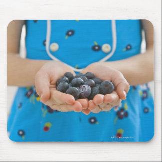 Girl holding fresh blueberries mouse mat