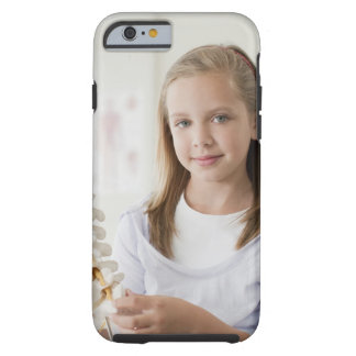 Girl holding model of spine in doctors office tough iPhone 6 case