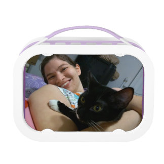 Girl hugging a cat lunch box