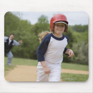 Girl in batting helmet running bases mouse pad